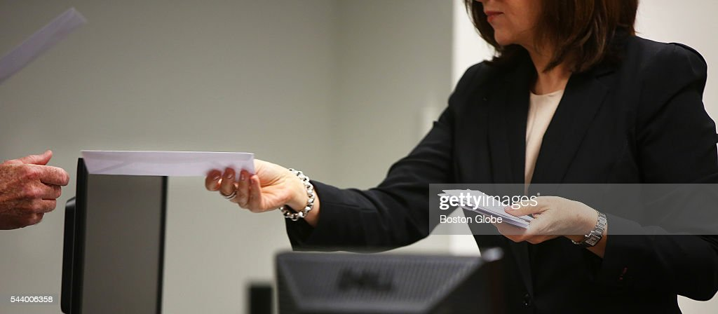 Because of the amount of attorneys in the courtroom, assistant judicial case manager Lesley Goldsmith takes self-addressed envelopes from those who want to be notified of any decisions. Attorneys representing various factions of Sumner M. Redstone's family argue over who should gain control of his media companies, in Norfolk County Probate Court in Canton, Mass., on June 30, 2016.