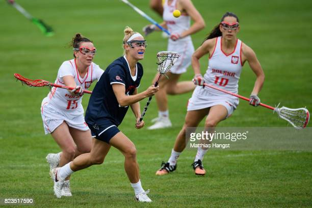 Becca Block of the United States is challenged by Kamila Sadowska of Poland during the Lacrosse Women's match between USA and Poland of The World...