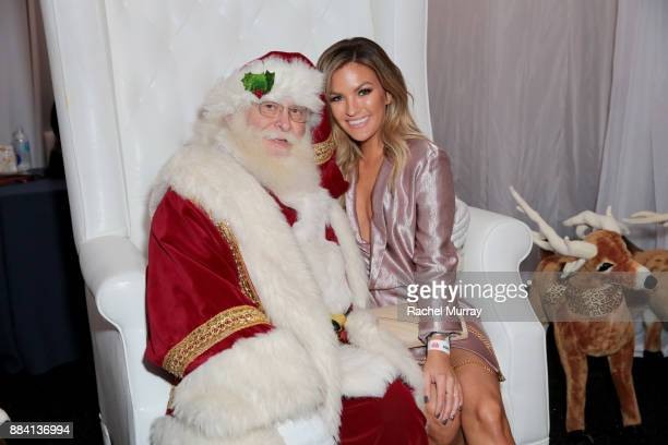 Becca Tilley poses with Santa Clause at the 1027 KIIS FM Artist Gift Lounge at 1027 KIIS FM's Jingle Ball 2017 presented by Capital One at The Forum...