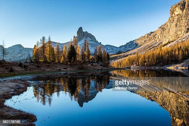 Becco di Mezzodì reflex in autumn in Federa lake