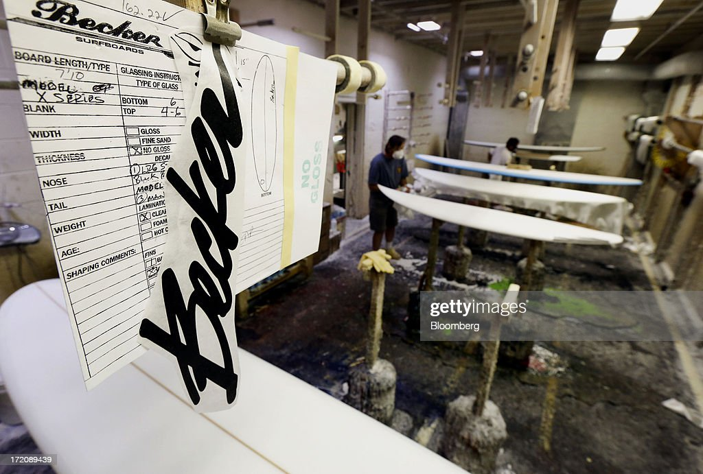 A Becker decal and order form hangs above a surfboard during the resin and lamination process at the Mangiagli Manufacturing facility in Hermosa Beach, California, U.S., on Monday, July 1, 2013. The U.S. Census Bureau is scheduled to release factory orders figures on July 2. Photographer: Patrick T. Fallon/Bloomberg via Getty Images