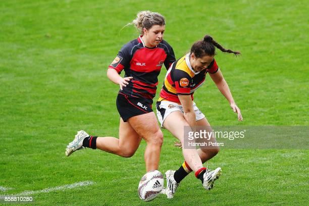 Becky Davidson of Canterbury chases Huia Harding of Waikato down during the round six Farah Palmer Cup match between Waikato and Canterbury at FMG...