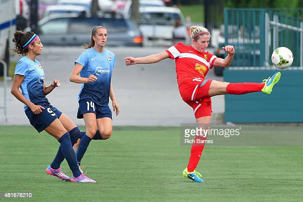 Becky Edwards of the Western New York Flash passes the ball in front of Sarah Killion and Nadia Nadim of the Sky Blue FC during the first half at...