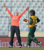 Becky Grundy of England celebrates dismissing Mignon du Preez of South Africa during the ICC Womens World Twenty20 Bangladesh 2014 semi final between...