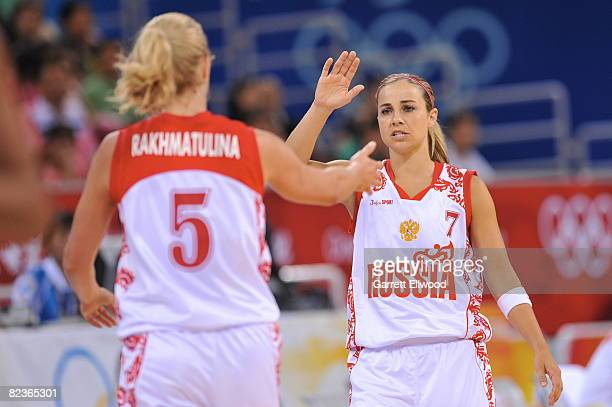 Becky Hammon celebrates with Oxana Rakhmatulina of Russia against Brazil during day 4 of the women's preliminary basketball game at the 2008 Beijing...
