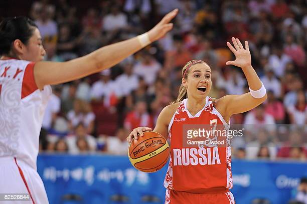 Becky Hammon of Russia calls a play against China during the women's bronze medal basketball game at the 2008 Beijing Olympic Games at the Beijing...