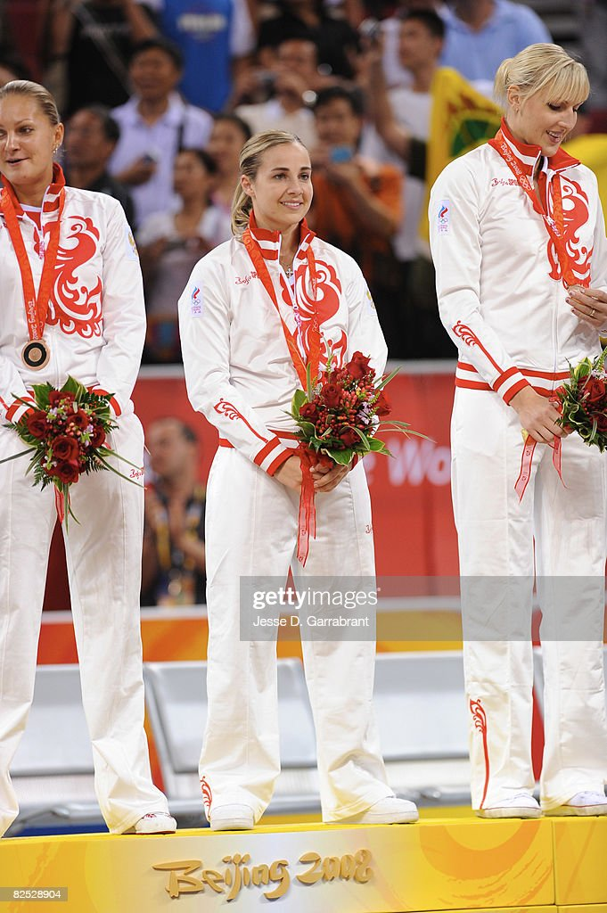 Becky Hammon #7 of Russia celebrates on the podium after winning the women's bronze medal at the 2008 Beijing Olympic Games at the Beijing Olympic Basketball gymnasium on August 23, 2008 in Beijing, China.