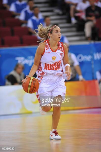 Becky Hammon of Russia dribbles against Brazil during day 4 of the women's preliminary basketball game at the 2008 Beijing Olympic Games at the...