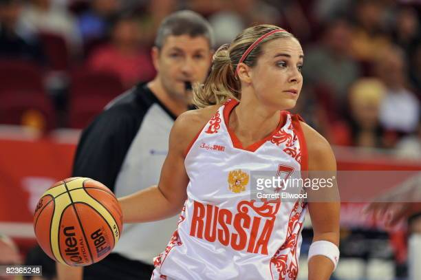 Becky Hammon of Russia drives against Brazil during day 4 of the women's preliminary basketball game at the 2008 Beijing Olympic Games at the Beijing...