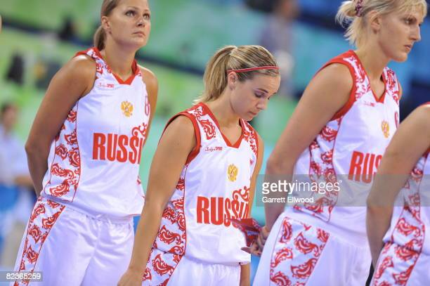 Becky Hammon of Russia stands for the national anthem against Brazil during day 4 of the women's preliminary basketball game at the 2008 Beijing...