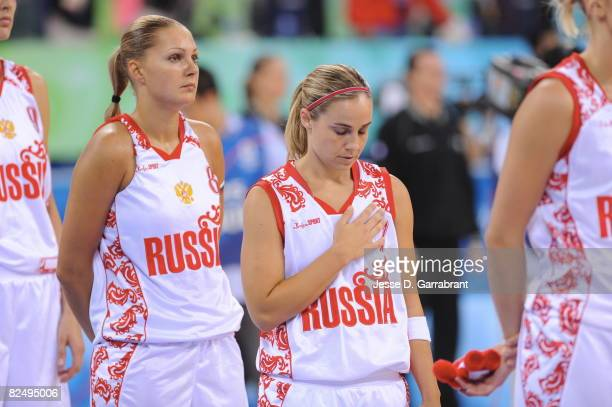 Becky Hammon of Russia stands for the national anthem prior to the game against the US Women's Senior National Team during the women's semifinals...