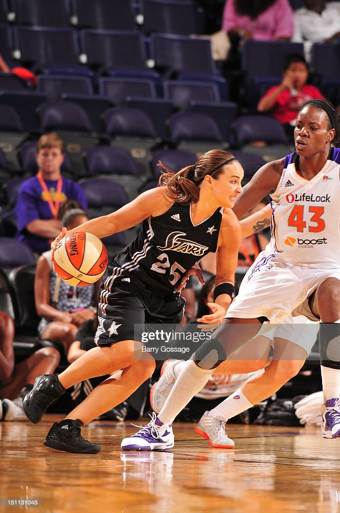 Becky Hammon of the San Antonio Silver Stars drives against Nakia Sanford of the Phoenix Mercury on September 1 2012 at US Airways Center in Phoenix...