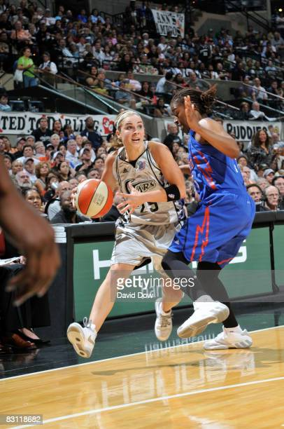 Becky Hammon of the San Antonio Silver Stars drives against Sheri Sam of the Detroit Shock in Game Two of the WNBA Finals on October 3 2008 at ATT...