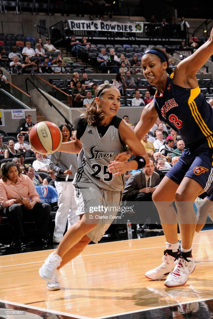 <a gi-track='captionPersonalityLinkClicked' href=/galleries/search?phrase=Becky+Hammon&family=editorial&specificpeople=203174 ng-click='$event.stopPropagation()'>Becky Hammon</a> #25 of the San Antonio Silver Stars drives against <a gi-track='captionPersonalityLinkClicked' href=/galleries/search?phrase=Tammy+Sutton-Brown&family=editorial&specificpeople=208212 ng-click='$event.stopPropagation()'>Tammy Sutton-Brown</a> #8 of the Indiana Fever at the AT&T Center on August 16, 2011 in San Antonio, Texas.