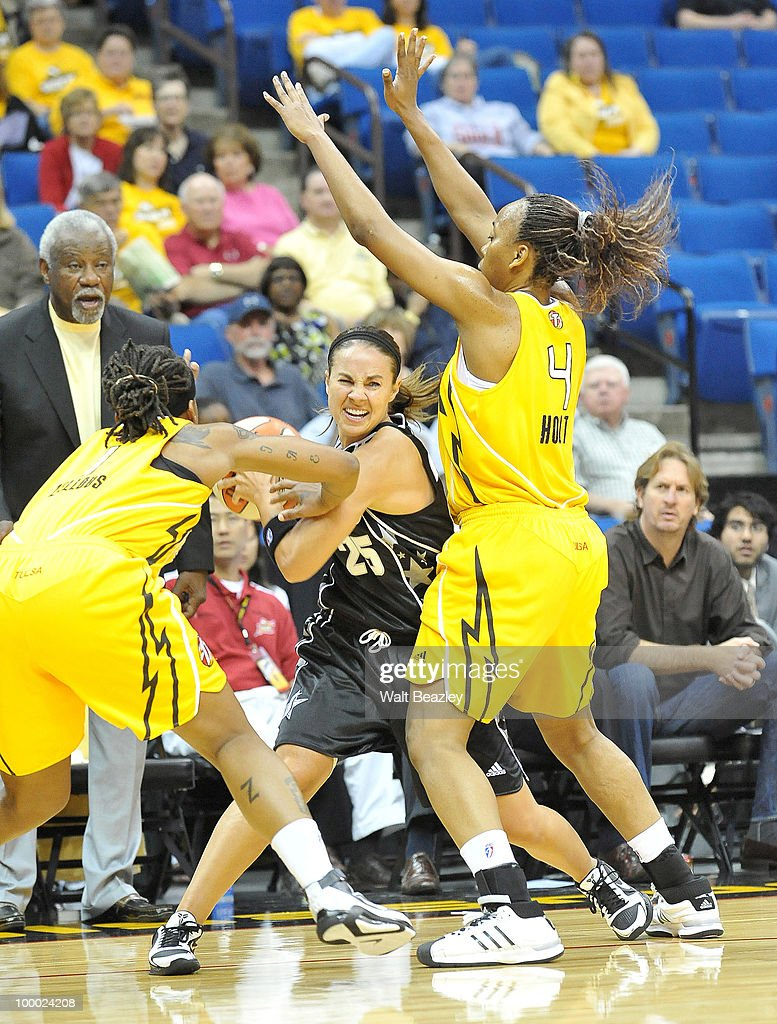 Becky Hammon #25 of the San Antonio Silver Stars fights for control of the ball against Shavonte Zellous #1 and Amber Holt #4 of the Tulsa Shock at the Bok Center May 20, 2010 in Tulsa, Oklahoma.