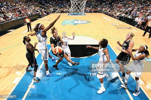 Becky Hammon of the San Antonio Silver Stars goes for the basket against Rebekkah Brunson of the Minnesota Lynx during the game on August 4 2011 at...