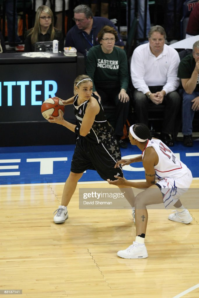 Becky Hammon of the San Antonio Silver Stars looks to drive against Deanna Nolan of the Detroit Shock during Game Three of the WNBA Finals on October...
