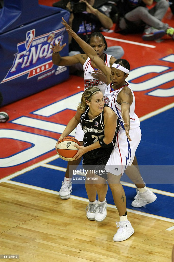 Becky Hammon of the San Antonio Silver Stars looks to pass against Deanna Nolan of the Detroit Shock during Game Three of the WNBA Finals on October...