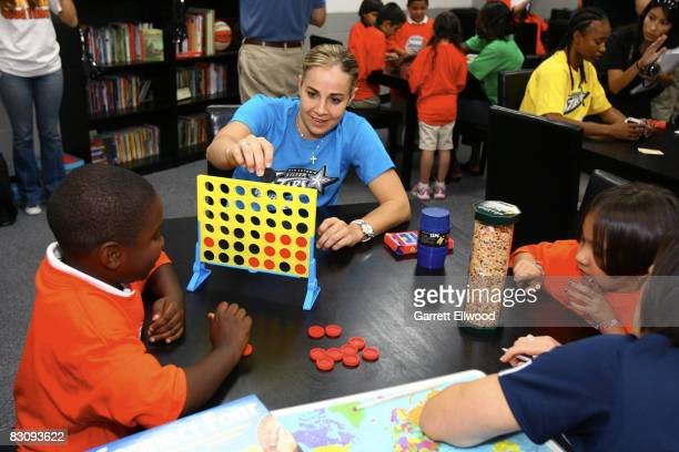 Becky Hammon of the San Antonio Silver Stars participates at the opening of a WNBA Cares Reading and Learning Center Dedication after Game One of the...
