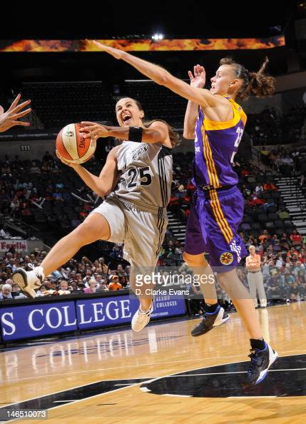Becky Hammon of the San Antonio Silver Stars shoots against Coco Miller of the Los Angeles Sparks at the ATT Center on June 16 2012 in San Antonio...