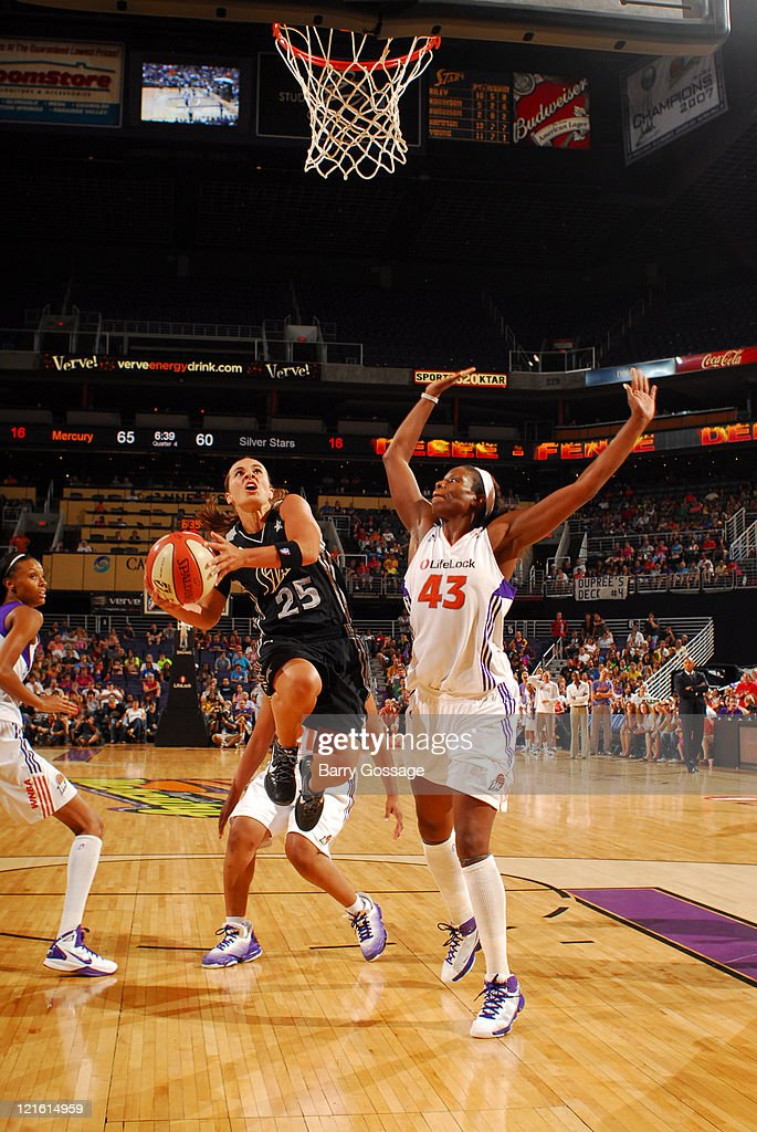 Becky Hammon of the San Antonio Silver Stars shoots against Nakia Sanford of the Phoenix Mercury on August 20 2011 at US Airways Center in Phoenix...