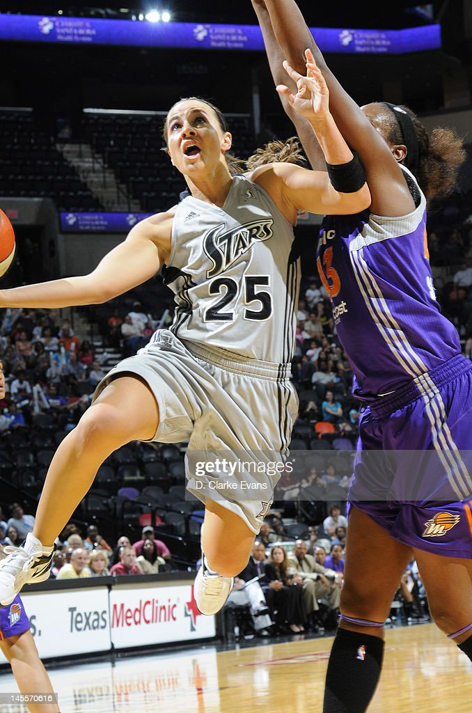 Becky Hammon of the San Antonio Silver Stars shoots against Nakia Sanford of the Phoenix Mercury at the ATT Center on June 1 2012 in San Antonio...