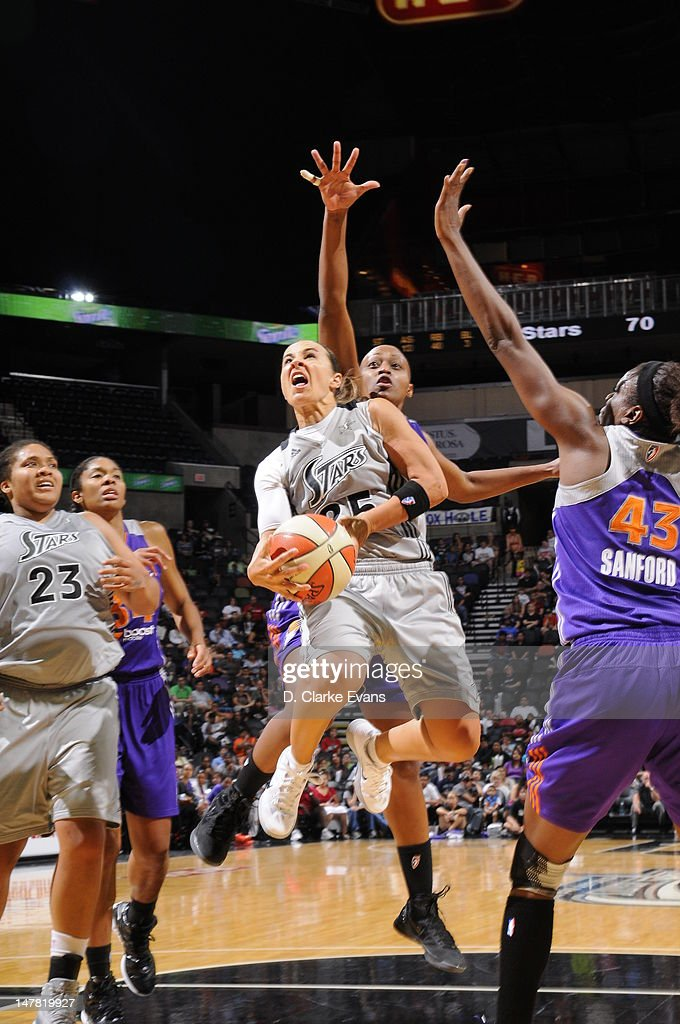 Becky Hammon of the San Antonio Silver Stars shoots against Nakia Sanford of the Phoenix Mercury at the ATT Center on July 3 2012 in San Antonio...