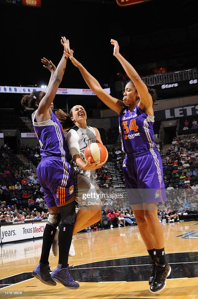 Becky Hammon of the San Antonio Silver Stars shoots against Nakia Sanford and Krystal Thomas of the Phoenix Mercury at the ATT Center on July 3 2012...