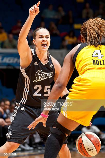 Becky Hammon of the San Antonio Silver Stars signals to her team under guard of Amber Holt of the Tulsa Shock during the WNBA game on August 17 2012...