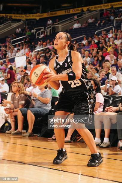 Becky Hammon of the San Antonio Silver Stars takes a jump shot against Diana Taurasi of the Phoenix Mercury during Game Three of the WNBA Western...