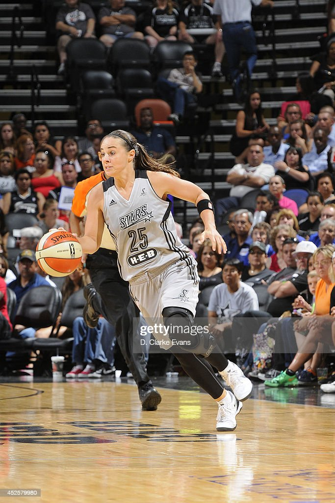 <a gi-track='captionPersonalityLinkClicked' href=/galleries/search?phrase=Becky+Hammon&family=editorial&specificpeople=203174 ng-click='$event.stopPropagation()'>Becky Hammon</a> #25 of the San Antonio Stars drives against the Seattle Storm at the AT&T Center on July 11, 2014 in San Antonio, Texas.