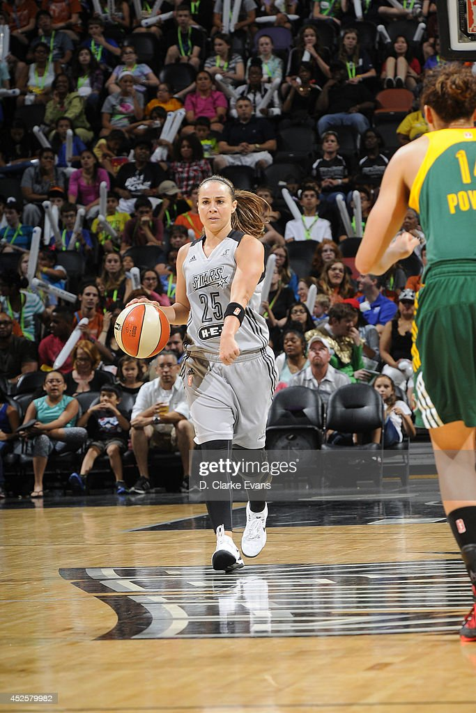 <a gi-track='captionPersonalityLinkClicked' href=/galleries/search?phrase=Becky+Hammon&family=editorial&specificpeople=203174 ng-click='$event.stopPropagation()'>Becky Hammon</a> #25 of the San Antonio Stars moves the ball up-court against the Seattle Storm at the AT&T Center on July 11, 2014 in San Antonio, Texas.