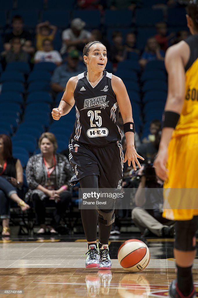 <a gi-track='captionPersonalityLinkClicked' href=/galleries/search?phrase=Becky+Hammon&family=editorial&specificpeople=203174 ng-click='$event.stopPropagation()'>Becky Hammon</a> #25 of the San Antonio Stars moves the ball up-court against the Tulsa Shock during the WNBA game on July 17, 2014 at the BOK Center in Tulsa, Oklahoma.