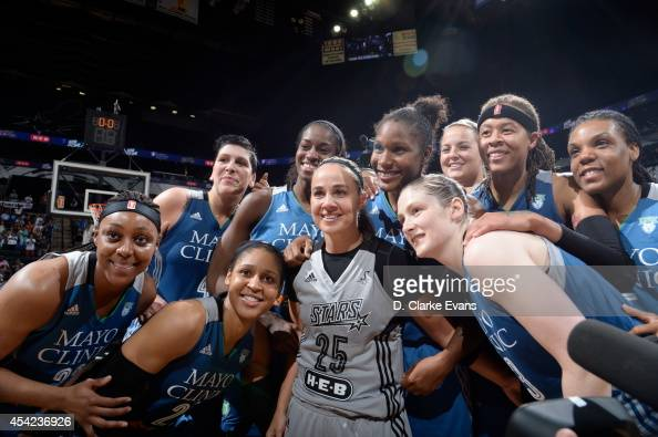 Becky Hammon of the San Antonio Stars poses with Monica Wright Maya Moore Lindsay Whalen Janel McCarville Devereaux Peters Rebekkah Brunson Tricia...