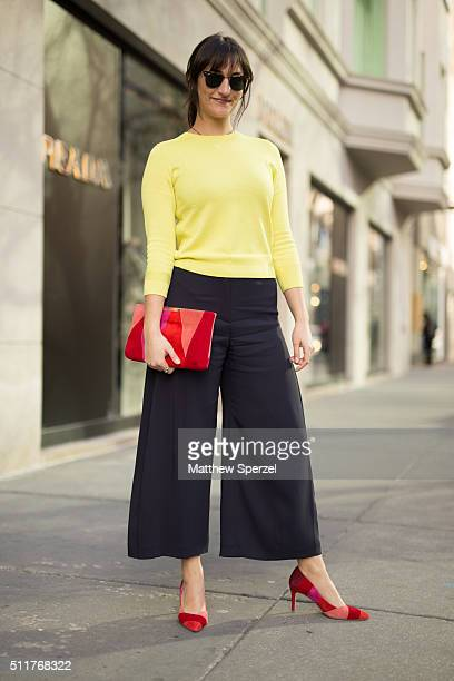 Becky Kriebel is seen on Oak Street wearing Ray Ban glasses LK Bennett yellow sweater and black culottes pants and red Patchwork shoes on February 20...