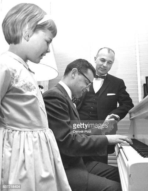 Becky Love daughter of Gov John Love and Sen Joe Shoemaker of Denver listen while Rep Joseph B Schieffelin of Golden plays the piano Monday night at...