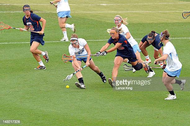 Becky Lynch of the North Carolina Tar Heels and Kelsey Gahan of the Virginia Cavaliers fight for a loose ball during the semifinals of the 2012...