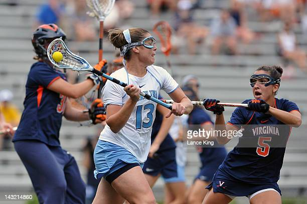 Becky Lynch of the North Carolina Tar Heels looks to pass against Megan Dunleavy of the Virginia Cavaliers during the semifinals of the 2012 Women's...