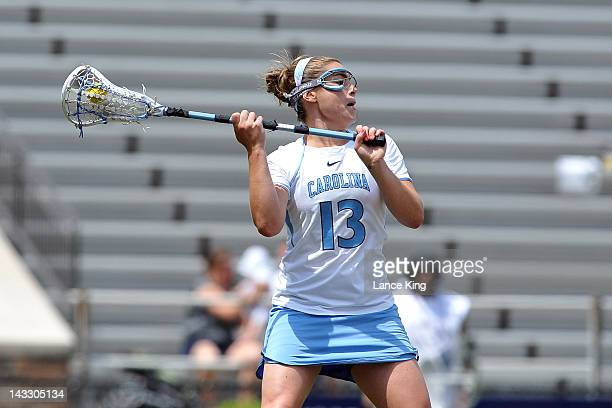Becky Lynch of the North Carolina Tar Heels looks to pass against the Virginia Cavaliers during the semifinals of the 2012 Women's ACC Tournament at...
