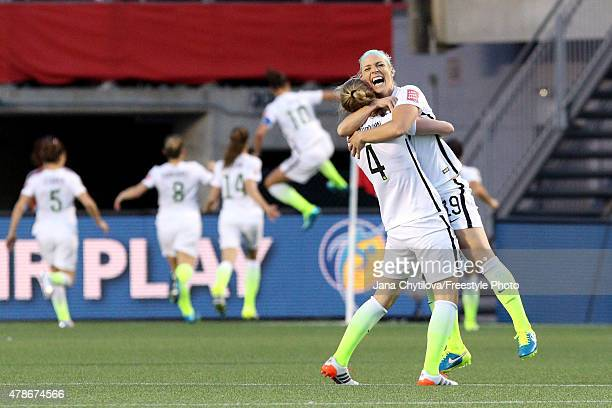 Becky Sauerbrunn and Julie Johnston of the United States celebrate after a goal by Carli Lloyd in the second half against China in the FIFA Women's...