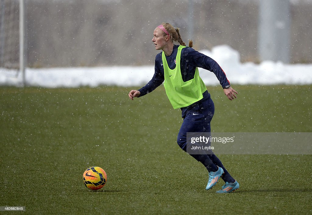 Becky Sauerbrunn looks to pass as the USA women's soccer team practices April 3 2014 at the Colorado School of Mines as they prepare for their...