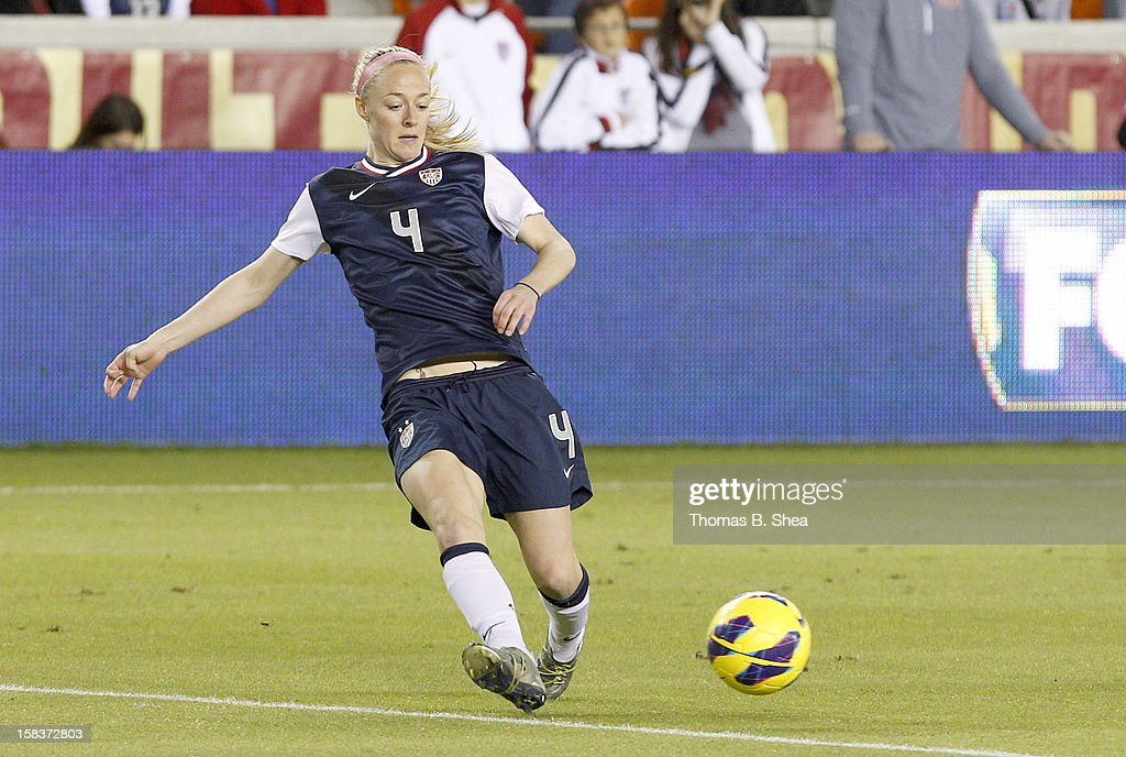 Becky Sauerbrunn #4 of the U.S. Women's National Team dribbles the ball against the China Women's National Team in an international friendly game at BBVA Compass Stadium on December 12, 2012 in Houston, Texas. USA won 4 to 0.