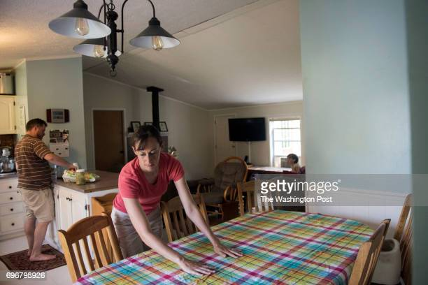 Becky Sell prepares the table for dinner while her husband Andy Sell sets out chips and salsa Sunday June 11 2017 Lauren Justice for The Washington...