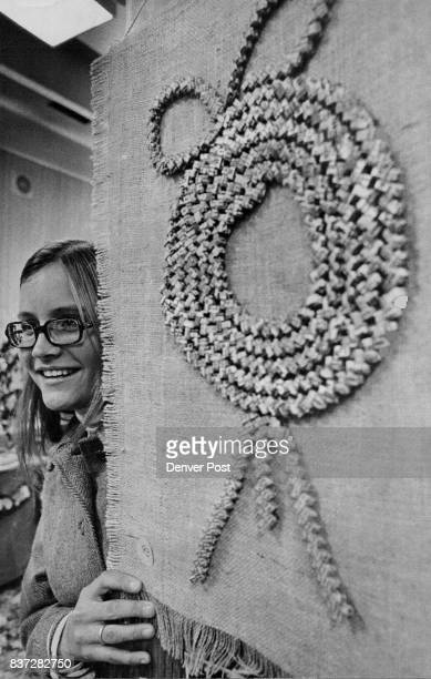 Becky Starzl's wall hanging of burlap with a wreath created from twisted gum wrappers won first prize in the youth division at the Festival of...
