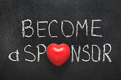 become a sponsor phrase handwritten on chalkboard with heart symbol instead of O