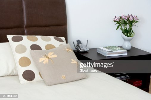 Bed and a side table in a bedroom : Stock Photo