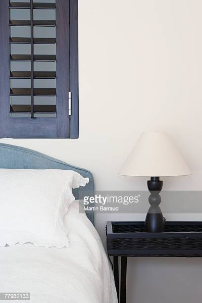 Bed and bedside table with lamp