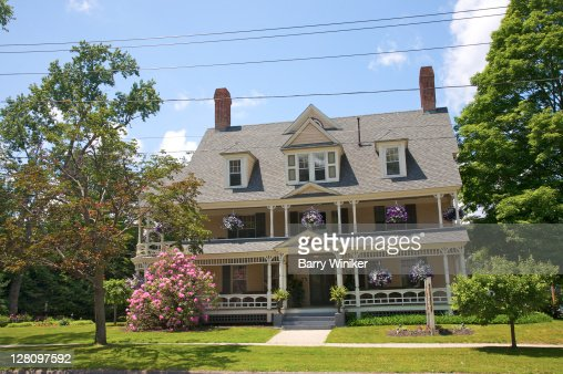 Bed and Breakfast with hanging baskets on porches in Great Barrington, The Berkshires, Massachusetts