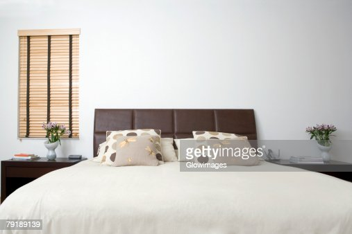 Bed and side tables in a bedroom : Foto de stock