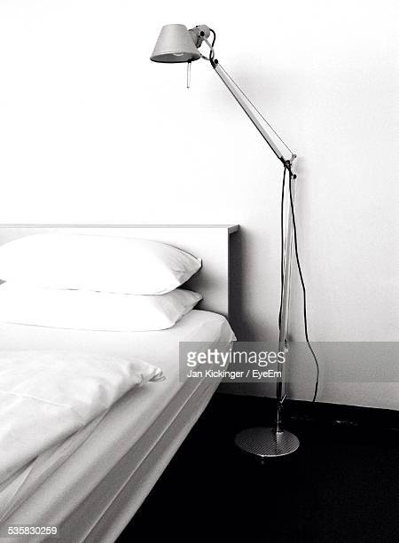 Bed By Electric Lamp At Home